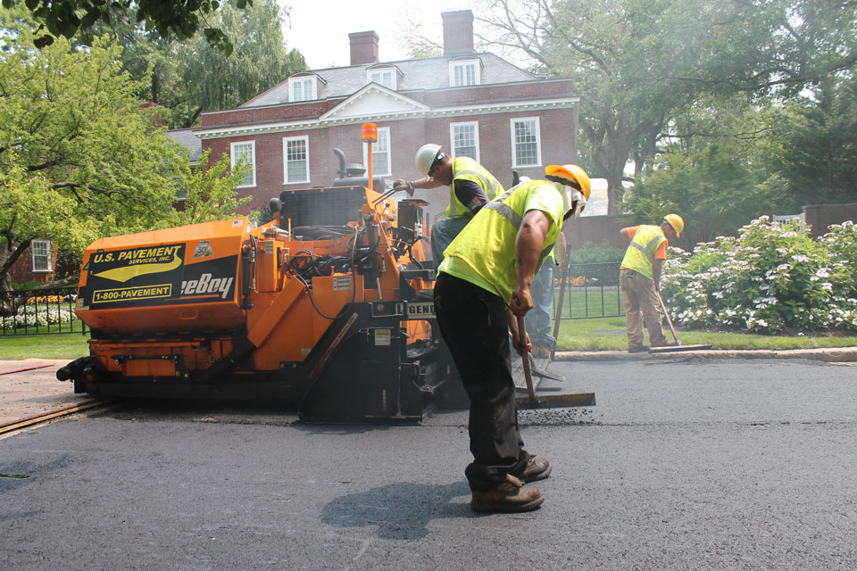 Construction Management Worker Smoothing out road
