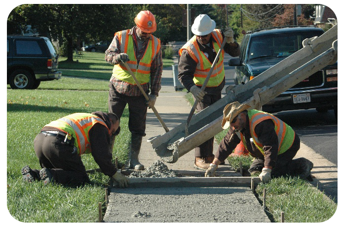 Workers Fixing sidewalk
