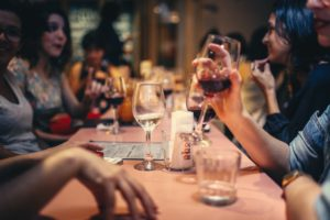 group at dinner with wine