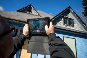 Man using tablet for code enforcement