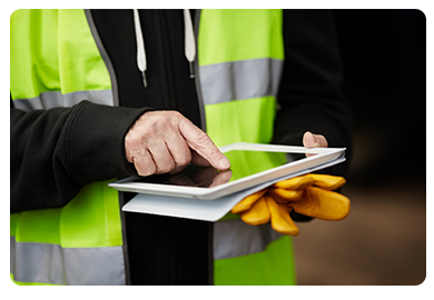 Construction Worker logging work order on tablet