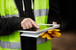 Man using ipad for work managment