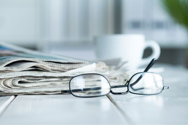 Table with Newspaper &  Glasses
